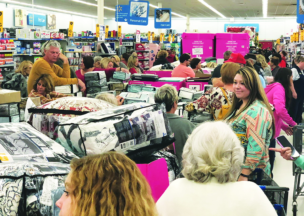 Walmart patrons in Murphy gather around displays of bed and bathroom items before Black Friday sales begin Thursday evening. Photo by Penny Ray