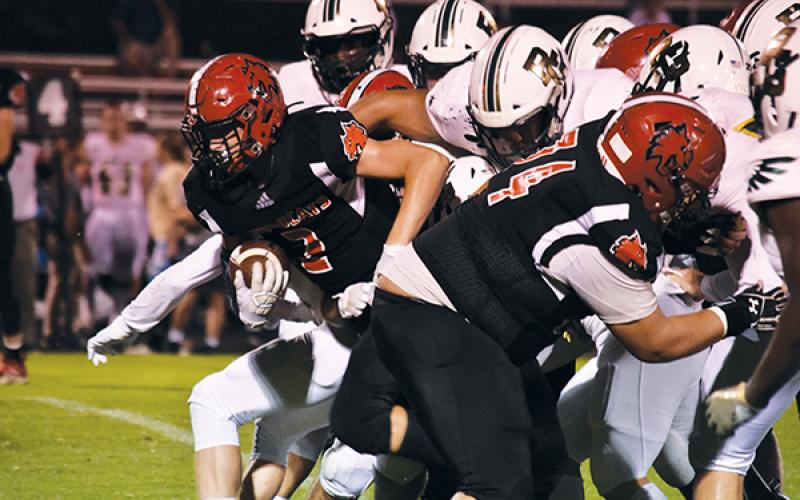 Andrews' Landon White pops out of the pack on a fourth-down run to convert during Friday's game against Rabun Gap.