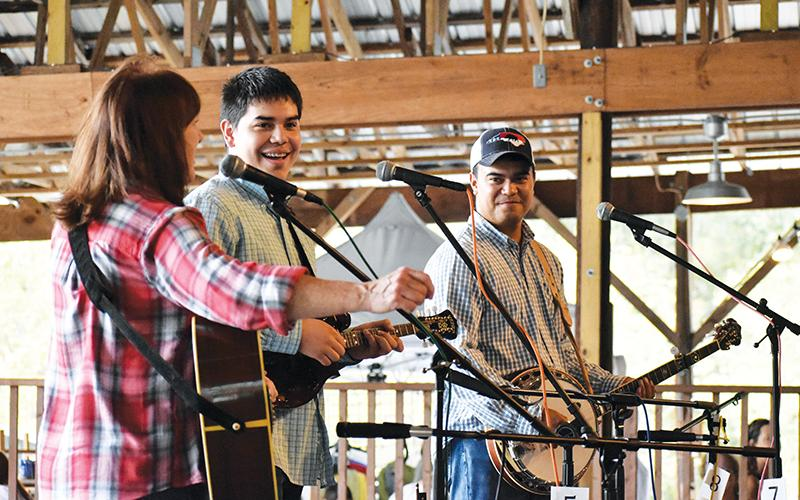 The Jones Brothers Band, featuring (from left) Betsy Blankenship, Joshua Jones and Johnathan Jones, played for the assembled guests at the Fall Festival in Brasstown over the weekend.