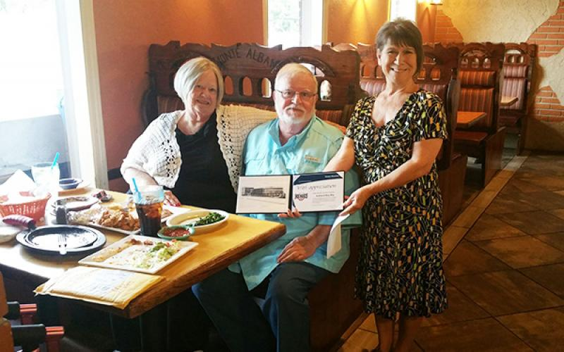 Mary and Andrew May (from left) are humbled with the Hometown Heroes award presented by Modern Woodman of America representative Linda May on Sept. 23 at Monte Alban in Andrews.