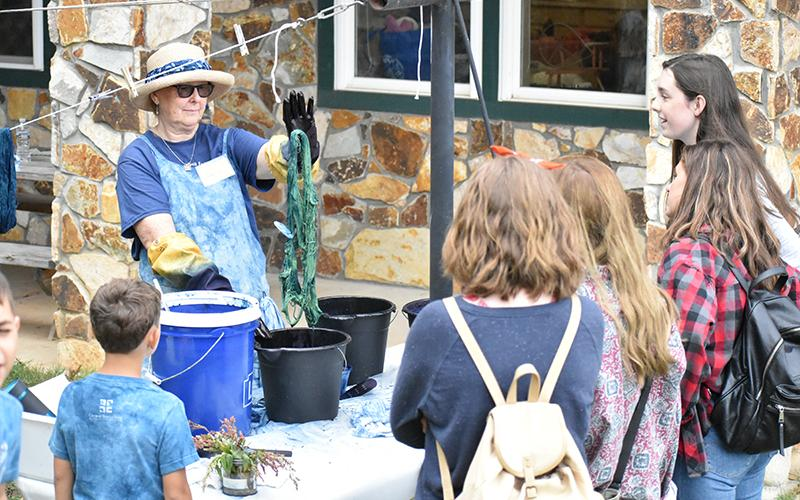 Salley Blackenship demonstrates indigo dying for the Fall Festival patrons.