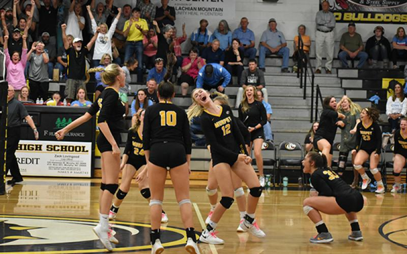 The Lady Dogs celebrate the match-winning point in their second round win over North Stanly.