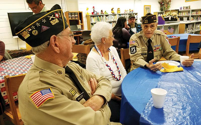 J.C. and Mary McCoy chat with Oscar Valdez (right) during the veterans breakfast provided by Martins Creek School on Tuesday morning.