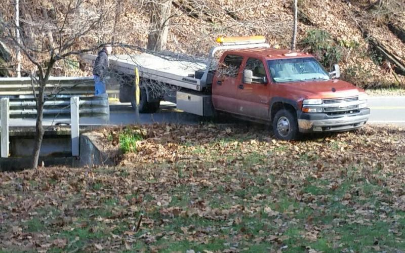 An abandoned vehicle was pulled out of a creek in Andrews Tuesday morning. (contributed photo)