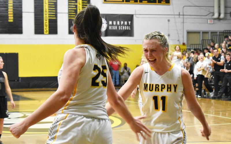 Murphy's Torin Rogers (11) emphatically celebrates an and-one layup by Sarah Pullium (25) in the Lady Bulldogs' dominant win against Hayesville. Photo by Noah Shatzer