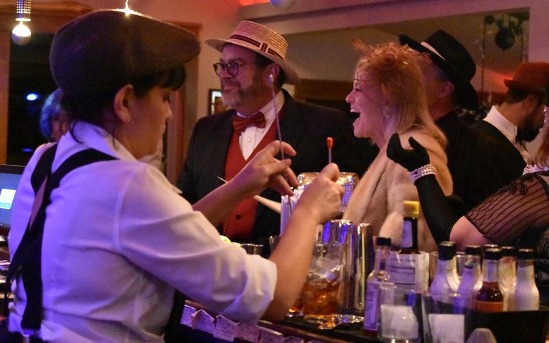 Greg and Beth Fidler of Warne enjoy celebrating at The Crown Brasstown as Andrea Garmon mixes drinks. Photo by Samantha Sinclair