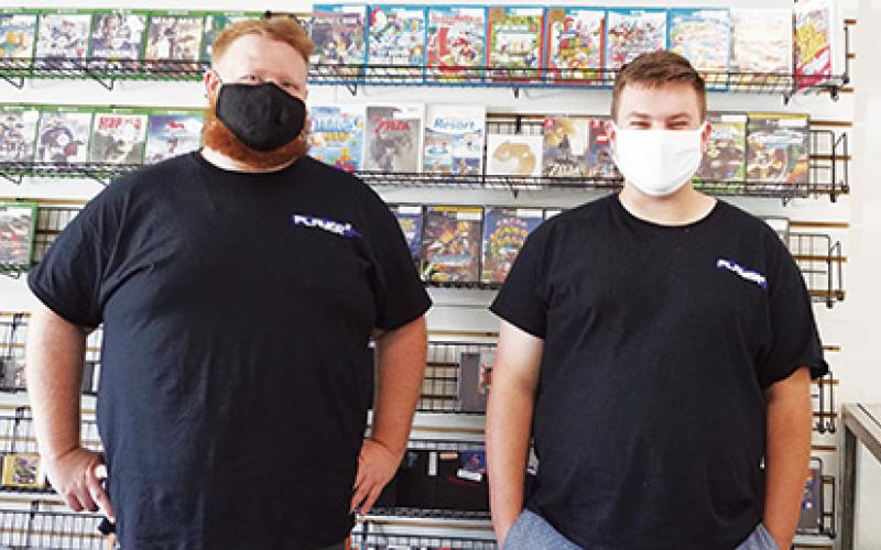 Local residents Dylan Winders (right) and Jonny Moore (left) have been collecting retro video games for years. They recently decided to open a retro game store dubbed Player 2 Gaming in Ranger. Photo by Noah Shatzer