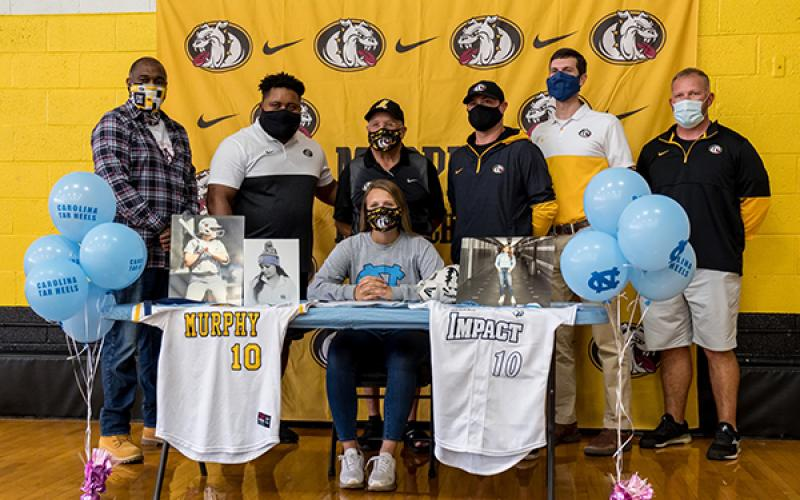 Murphy senior Annie Kate Dalton signed her letter of intent to play collegiate softball at the University of North Carolina in Chapel Hill on Thursday. Dalton, who will be kicking for the football team this season, was joined by coaches (from left) Mark Pickens, Thomas Nelson, David Gentry, Joseph Watson, Will Posey and Erik Laney.