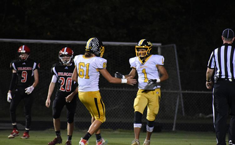 Murphy's Abram Abling (1) and Parker Posey (61) celebrate Abling's first career touchdown in the Bulldogs' win over Andrews.