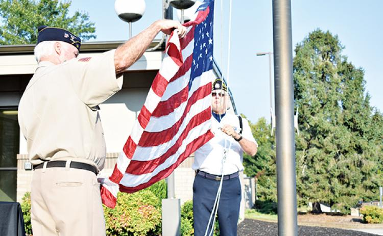 American Legion Posts 96 and 532 raised the flag to half staff on Patriot Day at Tri-County Community College.