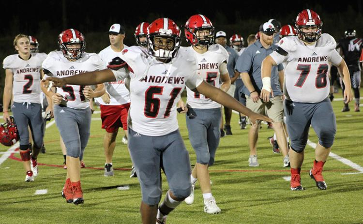 Makhi Smith (61) celebrates Andrews' win over the North Georgia Falcons. Photo by Mary White