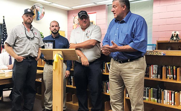 Murphy Electric Power Board employees (from left) John Hall, Chris Raper and Justin Coker, along with President Larry Kernea, accept a certificate of appreciation Thursday for their efforts in working on the playground at Murphy Elementary School.