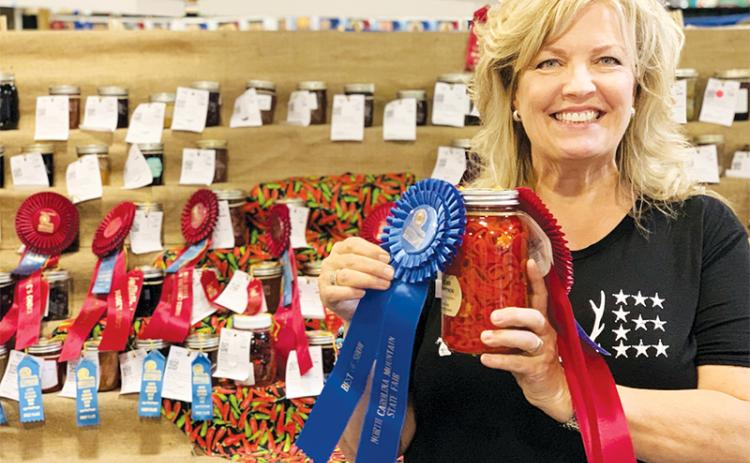 Rachael Linton Ritchie holds her award-winning sliced hot peppers in vinegar at the N.C. Mountain Fair. Photo courtesy of Rachel Linton Ritchie