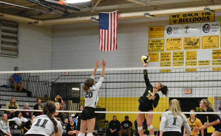 Murphy's Grace Nelson rises for a hit in the SMC Championship match.