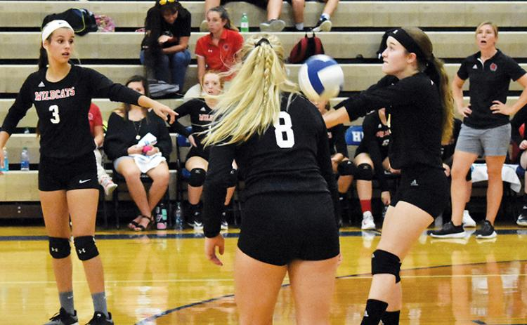 Andrews' Brooke Phillips returns a serve between teammates Sydney Postell (3) and Emma Jones (8) against Hiwassee Dam earlier this season.