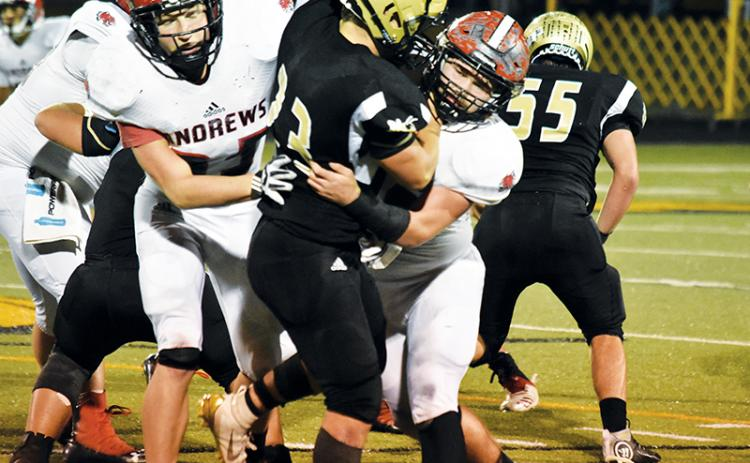 Andrews' Jimmy Miller wraps up Hayesville's Blake McClure during Friday night's game.