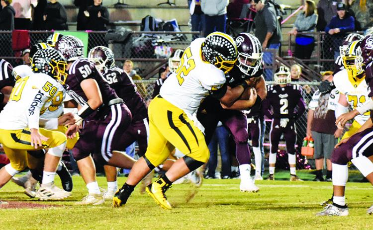 Murphy lineman Colby Stalcup records one of his two sacks Friday night during the Bulldogs' first win against the Swain Maroon Devils in Bryson City since 2005. Photo by Noah Shatzer