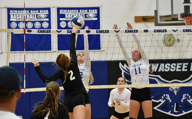 Andrews' Kinsleigh Dartez (2) looks to kill the ball with Hiwassee Dam's Ashlyn Weaver and Kayley Sells looking to block.