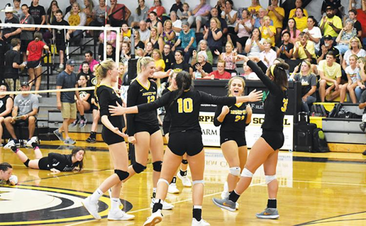 The Lady Bulldogs celebrate a point during their 3-1 victory in Murphy's rematch against the top-ranked Robbinsville Lady Knights on Oct. 3. Poto by Noah Shatzer