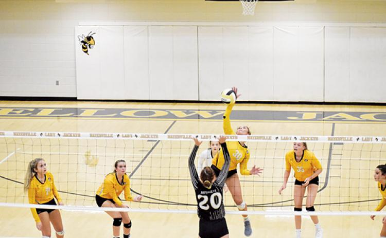 Hayesville's Halle Johnson (20) could use a hand as Murphy's Grace Nelson looks for a kill. Photo by Noah Shatzer