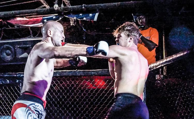 Former Murphy Bulldog Cory Farmer (right) lands a left jab against Gabriel Atkinson in his amatuer Mixed Martial Arts debut with Valor Fighting Challenge on Sept. 6. Photos by Janet Wohler/Valor Fighting Challenge