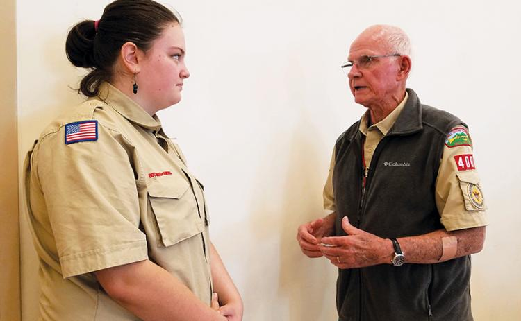 Dave Hotchkiss, charter organization representative for Scouting in Murphy, advises Troop 4400 Scout Cheyenne Griffith during Monday's veterans tribute at Peachtree Memorial Baptist Church. Photo by Samantha Sinclair/scoutingaround@cherokeescout.com