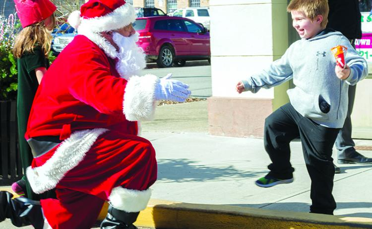 A child enjoys time with Santa during last year's event.