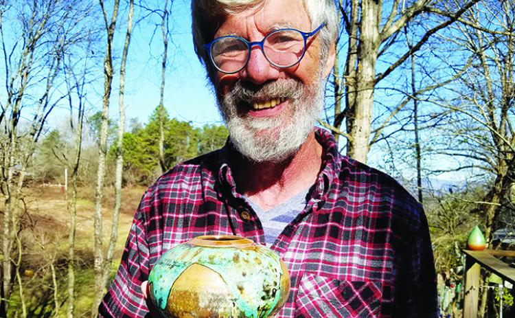 Harry Hearne creates raku pottery at Turning Point Clay Studio. Raku is only decorative, Hearne said, except for the lamps he makes. Photo by Samantha Sinclair