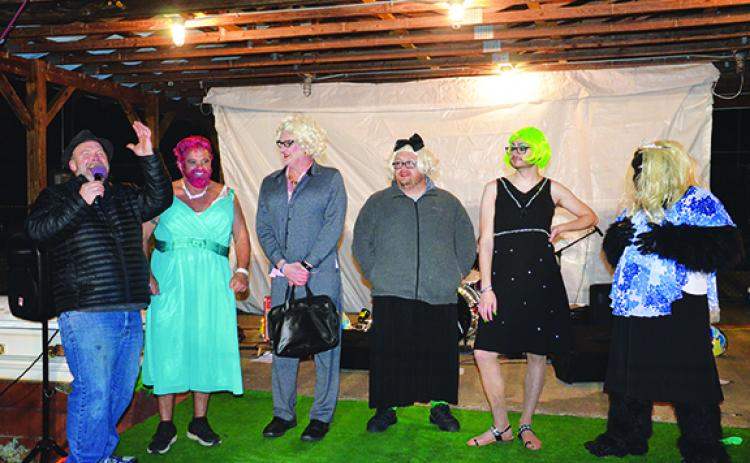 Andrews Mayor James Reid, Andrews Alderman Jonathan Ellison and Tim Radford from WKRK competed in the womanless beauty pageant, which was won by 20-year-old Paris Annas (wearing the green/yellow wig). Photo by Penny Ray