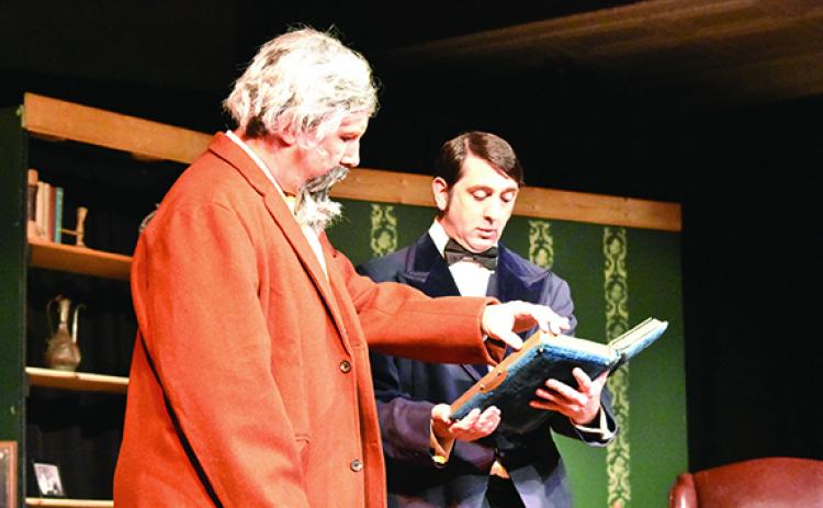 In A Perfect Likeness, Eric West (right) as Charles Dodgson shows Bill Butler as Charles Dickens photos of a young girl named Alice. The play will be shown Saturday night. Photo by Samantha Sinclair