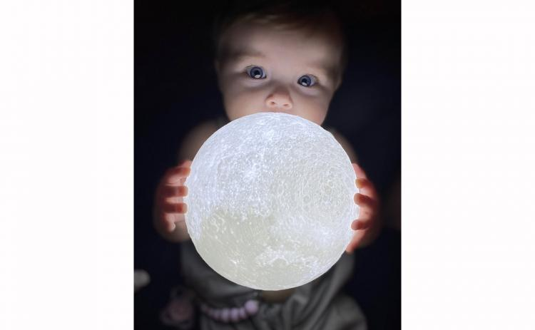 Aria Jade has never taken a bad photograph, including this one on Christmas Day while playing with the glowing moon ball she just opened.