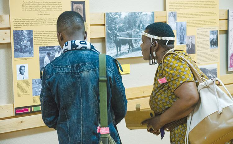 "Educators from Botswana - Ipatleleng M. Ntsayakgosi and Ookeditse Johannes - viewed the ""When All God's Children Get Together"" exhibit when it first visited the Murphy Art Center in 2017. File photo"