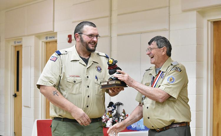 Murphy Cubmaster Josh Frentz accepts the Big Bear trophy from District Chairman Eddie Hollifield. Photo by Samantha Sinclair