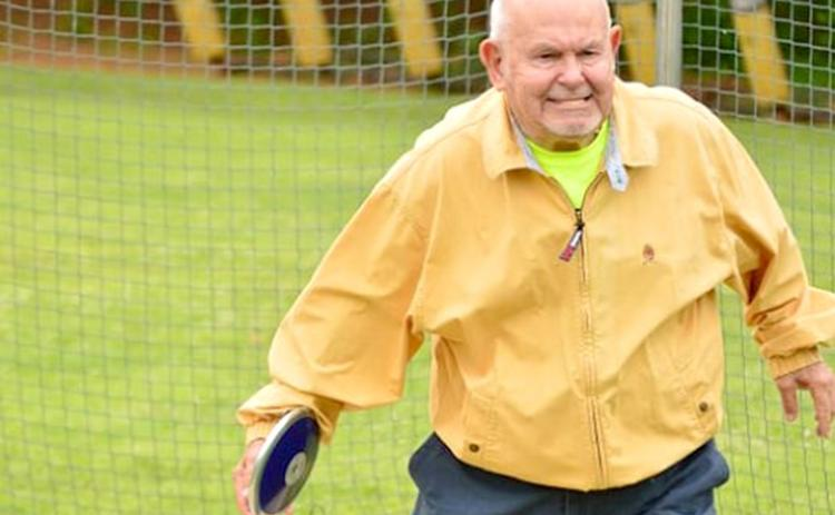Jim Paul lines up his discus throw during the 2014 Cherokee County Senior Games.