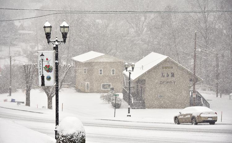 Snow practically created a whiteout Saturday morning at the L&N Depot in downtown Murphy. Photo by Samantha Sinclair