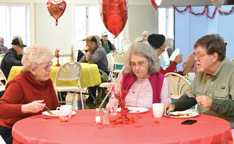 Helen Wilson, Margaret Bolick and James Bolick enjoy a meal together Saturday morning at the Konnaheeta Woman's Club annual Sweetheart Breakfast. Photo by Samantha Sinclair
