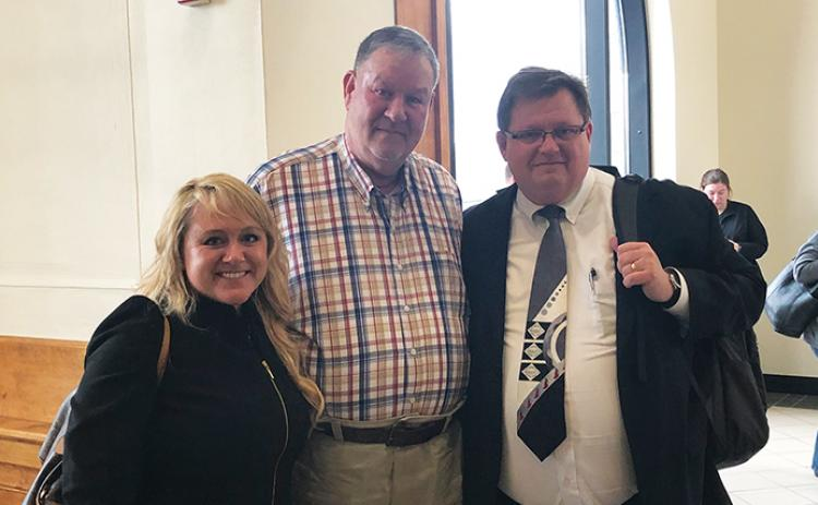 "Daniel Hughes (center) and his defense attorneys, Holly Christy and Rich Cassady, following the ""not guilty"" verdict Thursday at the Cherokee County Courthouse. Photo by Penny Ray"