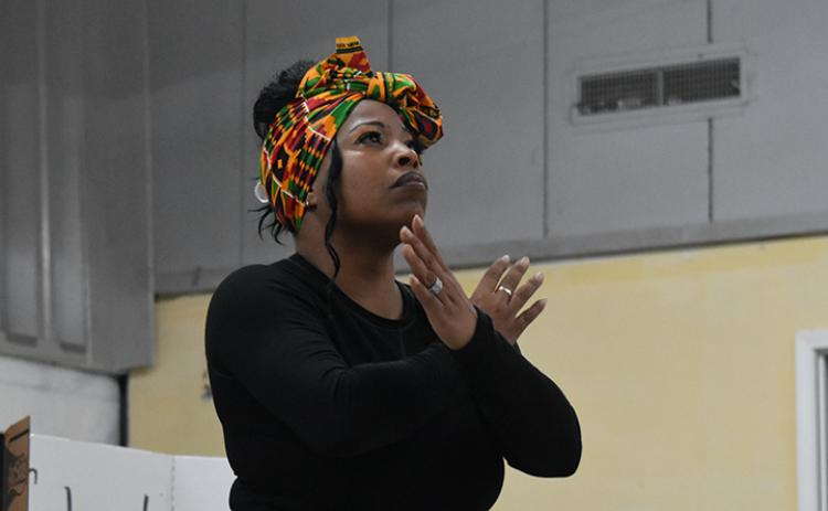 "Michelle Lloyd performs to ""Glory"" during the Artistic Expression Through Black Culture program on March 7. Lloyd said she did some research, but the ""spirit of the music"" moves her. Photo by Samantha Sinclair"