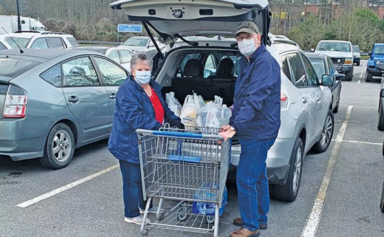 Richard and Mildred Pullium are taking precautions, but like most people still needed to go shopping Thursday. Photo by Sam Jokich