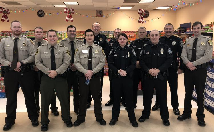 Local law enforcement officers joined forces to help children during Shop with a Cop in December.
