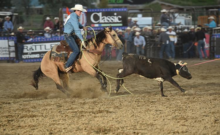 Acentric Rodeo/Contributing Photographer: Marble's Trevor Boatright ropes the hind legs of an escaping calf during the team roping competition during the National High School Finals rodeo in Guthrie, Okla.