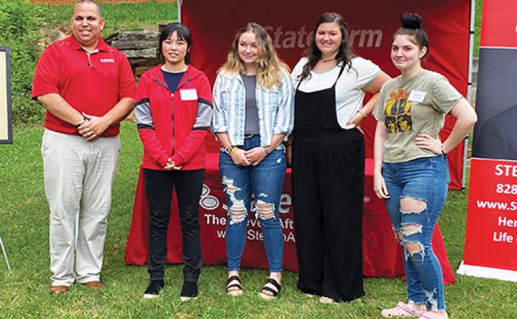 Steven Aft (far left) handed out the annual Extra Mile awards on June 17 at his State Farm Insurance office in Murphy. The Class of 2020 winners include (from left) Ayana Yan of Robbinsville, Isabella Rogers of Hayesville, Journie Newton of Murphy and Victoria Diaz of Andrews. Gracie Ledford of Hiwassee Dam arrived as the event was concluding. Photo by David Brown