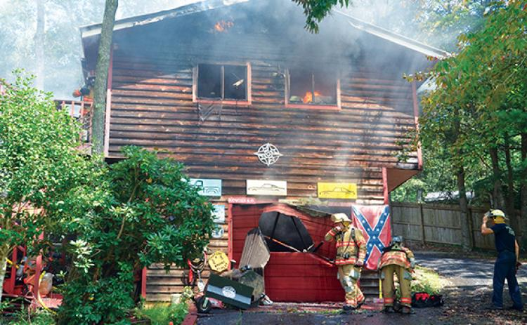 A fire destroyed a garage in the Tanglewood Forest housing development. Officials say a welding accident caused the blaze. Penny Ray/pennyray@cherokeescout.com