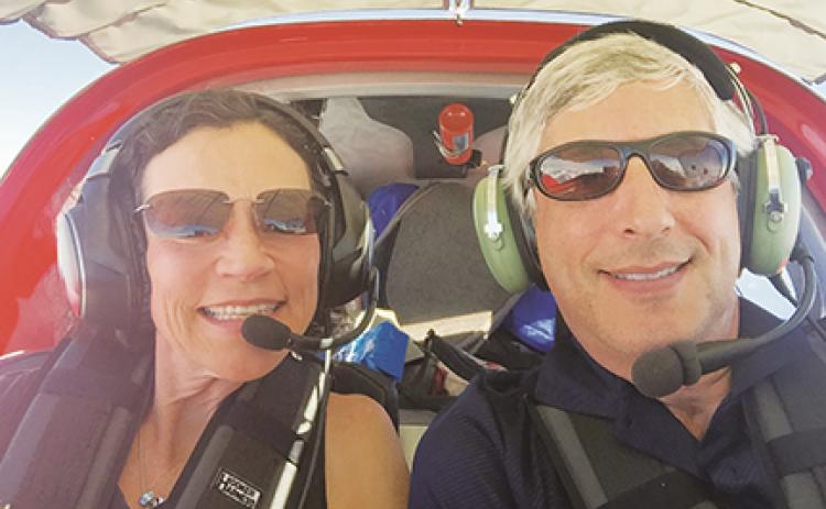 Anne Daley and Adam Molny flying in one of their planes. Daley purchased land more than 20 years ago that she recently donated to Cherokee County and will be sold through a sealed bid process.