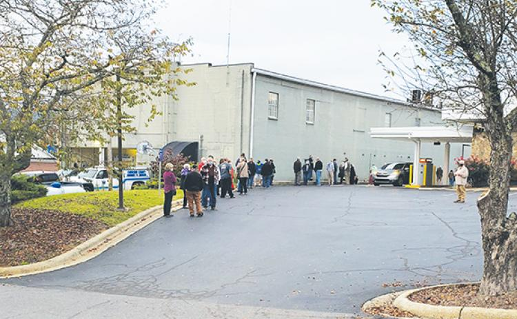 As early voting began Thursday morning, the line to vote wrapped along the side of the Cherokee County Courthouse Annex in downtown Murphy and along the edge of the parking lot for PNC Bank next door. Photo by Samantha Sinclair