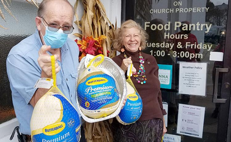 Steve Beavers and his wife, Patricia Rife-Beavers, are shown delivering gifts of frozen turkeys to the Sharing Center food pantry given in honor of her father, Ed Rife, who died recently but had been a volunteer worker at the center well into his 80s.