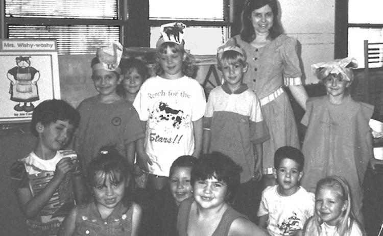 "One of Linda Holcomb's fond memories was when her Andrews Elementary School class acted out the Mrs. Wishy Washy book in 1995. The children's hats have pictures of who they were in the ""readers theater"" to have fun with the content of the book."