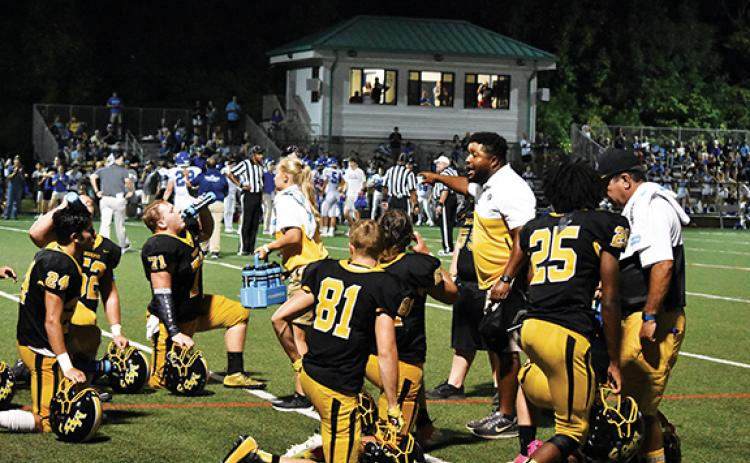 "Murphy High School assistant football coach Thomas Nelson fires up his players on the sidelines during a game in the 2019 season. However, his life shows Nelson's not really the ""bad guy."""